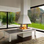 Camini moderni a legna: Piazzetta modello m360q focolare Tallin di colore bianco